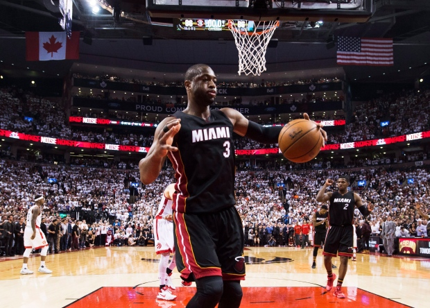 Wade gets 30, Heat rally and beat Raptors 94-87 in OT
