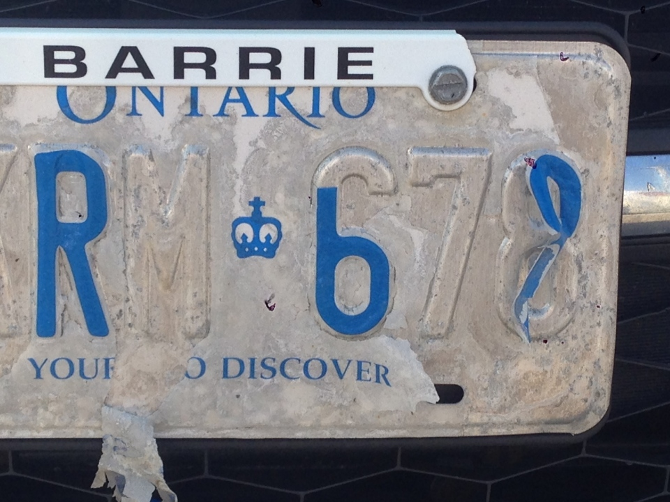 Peeling licence plate