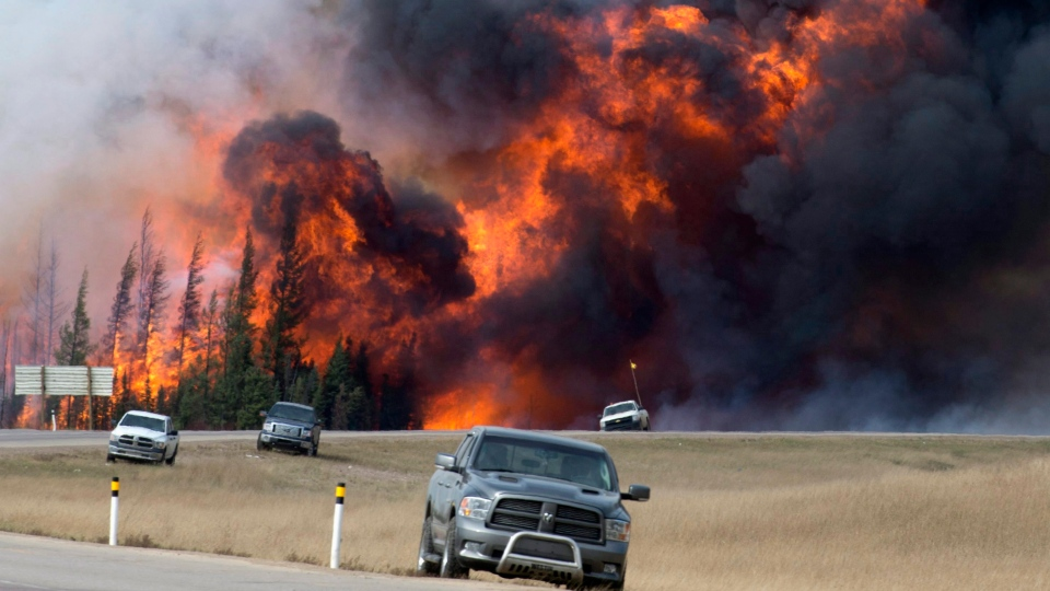 In this May 7, 2016 file photo, a wildfire burns south of Fort McMurray, Alberta. (Jonathan Hayward / The Canadian Press via AP, File)
