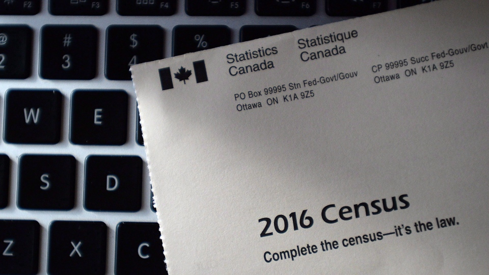 A Statistics Canada 2016 Census sits on the key board of a computer after arriving in the mail at a home in Ottawa in a May 2, 2016, file photo. (Sean Kilpatrick / THE CANADIAN PRESS)