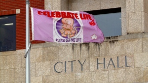 A pro-life flag flies outside Prince Albert's city hall on Tuesday, May 10, 2016.