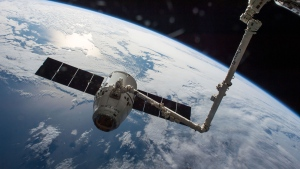 In this file photo, the SpaceX Dragon cargo spaceship is grappled by the International Space Station's Canadarm2.