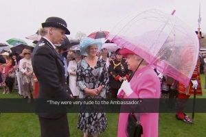 In image from video, Queen Elizabeth II speaks with Metropolitan Police Commander Lucy D'Orsi in the garden of Buckingham Palace in London, Tuesday, May 10, 2016.(Via AP Video)