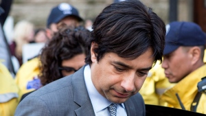 Former CBC radio host Jian Ghomeshi leaves a Toronto court after signing a peace bond, on Wednesday, May 11, 2016. (Chris Young / THE CANADIAN PRESS)