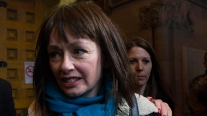 In this file photo, Lucy DeCoutere leaves the Toronto courthouse following the reading of the verdict in the Jian Ghomeshi sexual assault trial on Thursday, March 24, 2016. (Chris Young / THE CANADIAN PRESS)