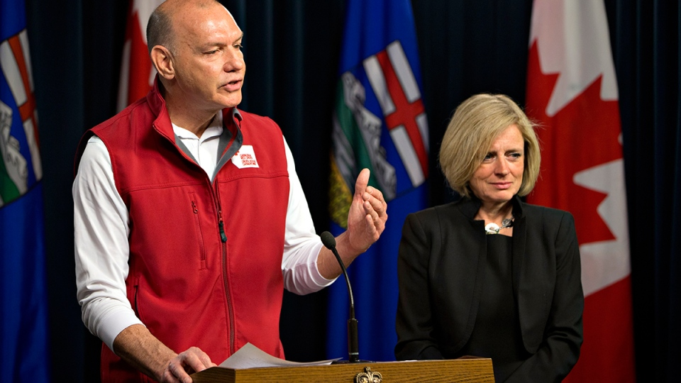 Conrad Sauve, President and CEO, Canadian Red Cross and Alberta Premier Rachel Notley announce details of emergency funds for Fort McMurray wildfire evacuees in Edmonton, on Wednesday, May 11, 2016. (Jason Franson / THE CANADIAN PRESS)