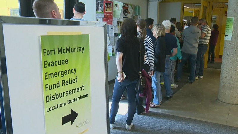 Hundreds of Fort McMurray evacuees lined up at the Butterdome in Edmonton to receive their emergency funds from the Alberta government.