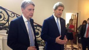 U.S. Secretary of State John Kerry, right, and British Foreign Secretary Philip Hammond speak to reporters at Carlton Gardens in London on May 12, 2016. (Josh Lederman / AP)