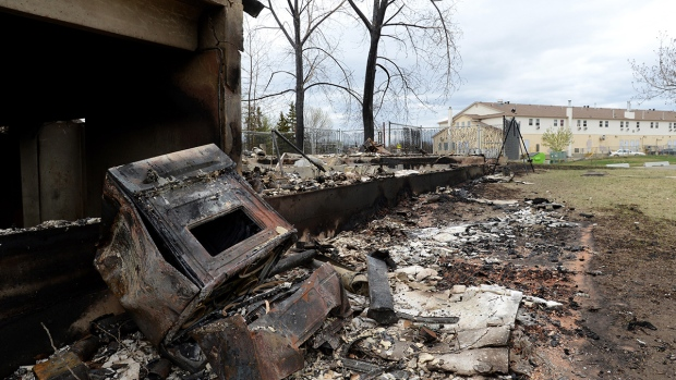 A charred oven is shown in Fort McMurray