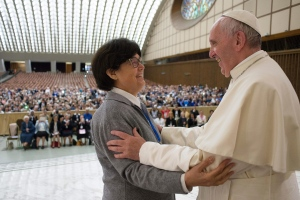 Pope Francis hugs Sister Carmen Sammut, a Missionary Sister of Our Lady of Africa at the end of a special audience with members of the International Union of Superiors General in the Paul VI Hall at the Vatican, Thursday, May 12, 2016. (L'Osservatore Romano/Pool photo via AP)