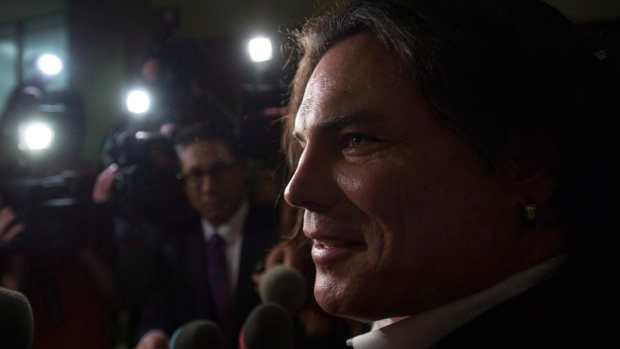 Senator Patrick Brazeau talks to media as he leaves the Gatineau Courthouse in Gatineau, Quebec, on Oct. 28, 2015. (Sean Kilpatrick /  THE CANADIAN PRESS)