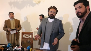 In this Thursday, March 17, 2016 photo, Amin Karim, second right, an official of the Hezb-i-Islami Party, speaks as he leaves after a press conference in Kabul, Afghanistan. (AP / Rahmat Gul)
