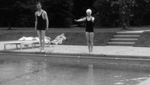 This undated handout photo provided by HM The Queen shows the then Princess Elizabeth swimming with her father, King George VI in Britain. Rare footage of Britain's Queen Elizabeth has been shared to celebrate her 90th birthday. (HM The Queen via AP) NO SALES - NO ARCHIVES