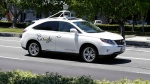 A Google self-driving car goes on a test drive near the Computer History Museum in Mountain View, Calif. on May 13, 2014. (AP / Eric Risberg)