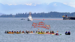 Break Free PNW kayaktivists unfurl their banner while out on the water in Fidalgo Bay east of Seafarer's Memorial Park in Anacortes, Wash., Friday, May 13, 2016. (Scott Terrell/Skagit Valley Herald via AP)