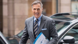 Conservative MP Maxime Bernier arrives outside the offices of the Conservative Party of Canada as he officially launches his bid for the leadership of the party, on Thursday, April 7, 2016 in Ottawa. (Justin Tang / THE CANADIAN PRESS)