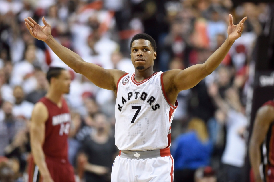 Toronto Raptors' Kyle Lowry gestures as he's taken out of the game during the fourth quarter of Eastern Conference semifinal NBA playoff basketball action against the Miami Heat in Toronto on Sunday, May 15, 2016. (Frank Gunn / THE CANADIAN PRESS)