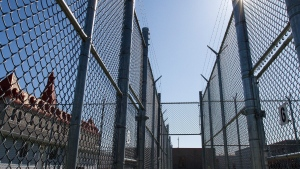Fences with razor wire are shown at Collins Bay Institution in Kingston, Ont., on Tuesday, May 10, 2016. (The Canadian Press/Lars Hagberg)