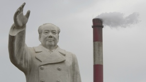 An enormous statue of Mao Zedong looms over the No. 1 Tractor Factory in Luoyang in central China's Henan province on Monday, May 2, 2016. (AP / Ng Han Guan)