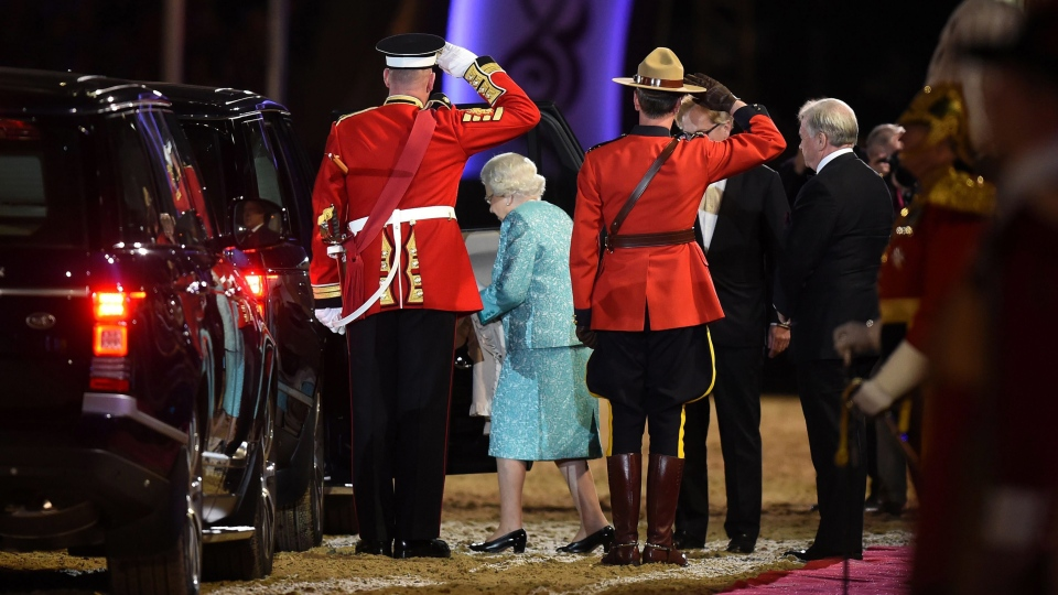 Queen Elizabeth II, center, leaves after the televised celebration of her 90th birthday in the grounds of Windsor Castle in Berkshire, Sunday May 15, 2016. (Chris Jackson//PA via AP)
