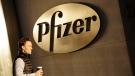 A man enters Pfizer's world headquarters, in New York on Nov. 24, 2015. (AP Photo/Mark Lennihan, File)