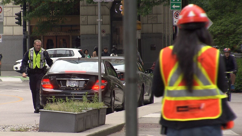 Vancouver police disguised as traffic flaggers helped bust drivers for dangerous behaviour in construction zones on May 16, 2016. (CTV)