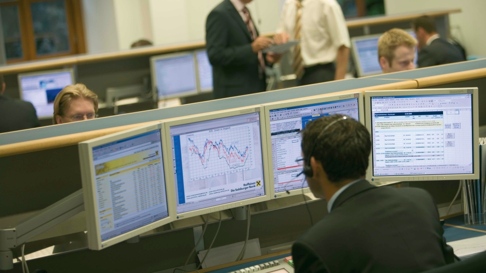 A trader analyzes investments.