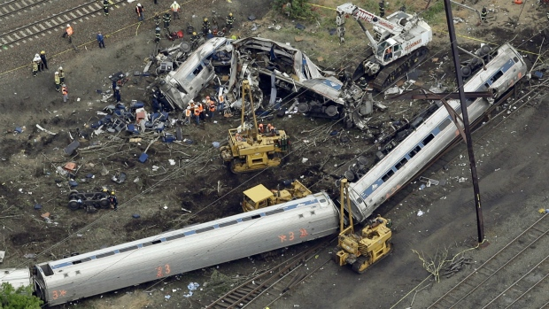 Emergency personnel work at the scene of a Tuesday night derailment in Philadelphia of an Amtrak train headed to New York on Wednesday, May 13, 2015. (AP / Patrick Semansky)