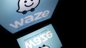 "The logo of mobile app ""Waze"" is pictured. (AFP PHOTO / LIONEL BONAVENTURE)"