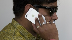 An Indian man talks on his iPhone in New Delhi, India, Wednesday, May 18, 2016. (AP / Tsering Topgyal)