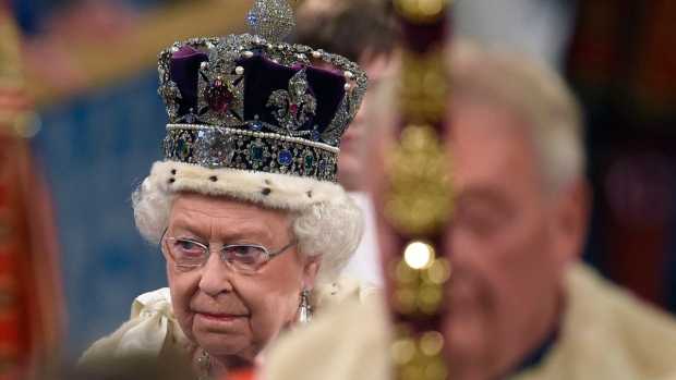Queen Elizabeth II proceeds through the Royal Gallery before the State Opening of Parliament in the House of Lords, at the Palace of Westminster in London, on May 18, 2016. (Toby Melville / Pool via AP)