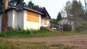 A boarded-up home is shown in the small hamlet town of Jordan River in this May 2016 photo. (CTV Vanocuver Island)