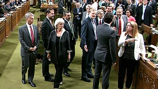 Prime Minister Justin Trudeau engaged in a heated exchange with NDP Leader Thomas Mulcair after Trudeau crossed the floor and extended his arm to guide a whip through a crowd of MPs.