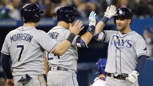 Tampa Bay Rays' Kevin Kiermaier, right, gets high fives at home plate after he hit a two run home run against the Toronto Blue Jays during fifth inning AL baseball action in Toronto Wednesday May 18, 2016. THE CANADIAN PRESS/Fred Thornhill