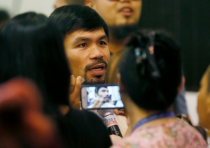 Filipino boxing great and now Senator Manny Pacquiao talks to the media shortly after being proclaimed the Seventh Senator in ceremony at the Commission on Elections Thursday, May 19, 2016 in suburban Pasay city south of Manila, Philippines. (AP Photo/Bullit Marquez)