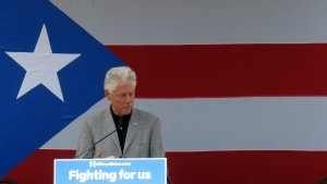 Former U.S. President Bill Clinton stumps for his wife, presidential candidate Hillary Clinton, in Bayamon, Puerto Rico, Tuesday, May 17, 2016. (AP Photo/Danica Coto)