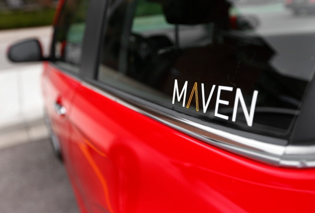 This April 27, 2016, file photo, shows the Maven logo on a General Motors car-sharing service automobile, in Ann Arbor, Mich. General Motors announced Thursday, May 19, it is expanding its Maven car-sharing service to Boston, Chicago and Washington, D.C. (AP Photo/Paul Sancya, File)