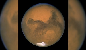 This Aug. 26, 2003 image made available by NASA shows Mars as it lines up with the Sun and the Earth. (NASA/J. Bell - Cornell U./M. Wolff)