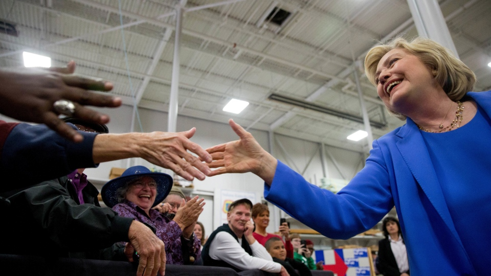 Democratic presidential candidate Hillary Clinton greets supporters as she arrives to speak at the Union of Carpenters and Millwrights Training Center during a campaign stop in Louisville, Ky., Sunday, May 15, 2016. (AP Photo/Andrew Harnik)