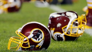 In this Dec. 26, 2015, file photo, a Washington Redskins helmet sits on the field as players warm-up before an NFL football game against the Philadelphia Eagles in Philadelphia. (AP Photo/Matt Rourke)