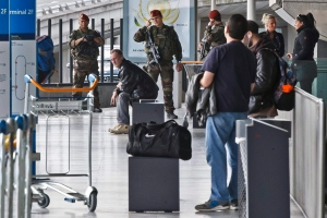 In this March 22 file photo, French soldiers patrol at bus station of Charles de Gaulle airport, in Roissy, north of Paris. (AP / Michel Euler)