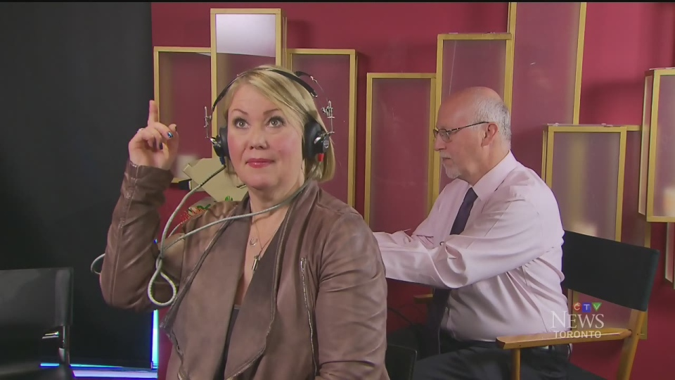 Jann Arden takes a hearing test of her own with audiologist Marshall Chasin in Toronto on May 20, 2016. She passed.