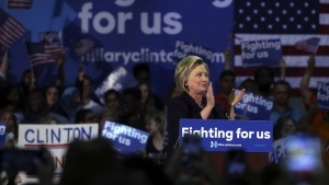 Clinton grapples with Trump's ability to stay in spotlight