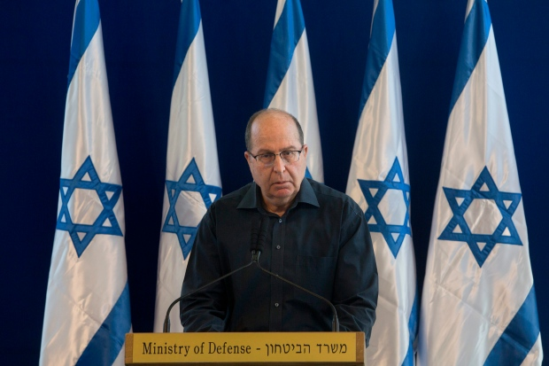 Israel's Defence Minister Moshe Yaalon, speaks during a press conference at the Defence Ministry in Tel Aviv, Israel, Friday, May 20, 2016.He announced his resignation on Friday, citing a lack of 'trust' in Prime Minister Benjamin Netanyahu. (AP Photo/Sebastian Scheiner)