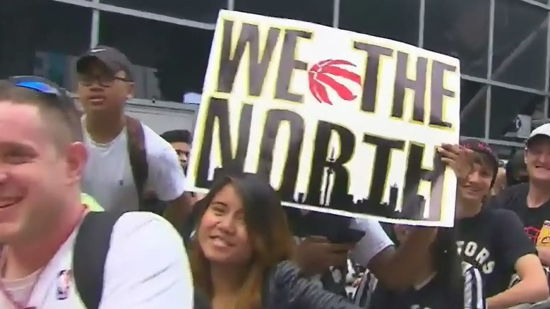 Toronto Raptors fans with a 'We The North' sign.