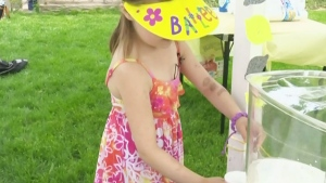 A girl is shown pouring lemonade in this file photo.