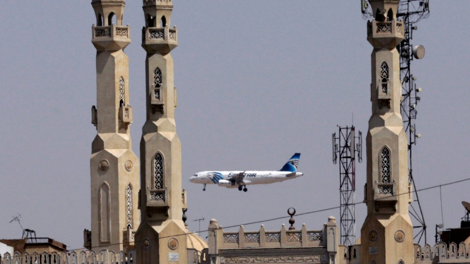 An EgyptAir plane flies past minarets of a mosque as it approaches Cairo International Airport, in Cairo, Egypt, Saturday, May, 21, 2016. (AP / Amr Nabil)