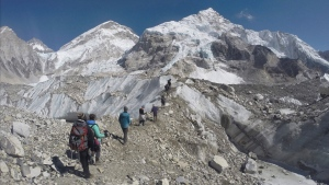 In this Monday, Feb. 22, 2016 file photo, international trekkers pass through a glacier at the Mount Everest base camp, Nepal. (AP / Tashi Sherpa, file)