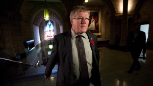 Conservative Sen. Don Plett arrives at the Senate on Parliament Hill in Ottawa on Monday, October 28, 2013. THE CANADIAN PRESS/Sean Kilpatrick