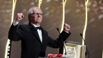 Director Ken Loach reacts after winning the Palme d'or for the film I, Daniel Blake, during the awards ceremony at the 69th international film festival, Cannes, southern France, Sunday, May 22, 2016. (AP / Thibault Camus)